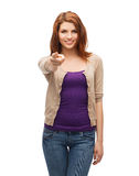 Happy girl in casual clothes pointing at you Stock Photos