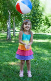 Happy girl catching ball outdoors Royalty Free Stock Photography