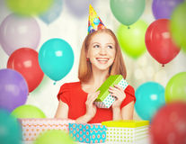 Happy girl celebrating birthday with balloons and gifts Stock Image