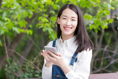 Happy girl and cell phone Royalty Free Stock Photography