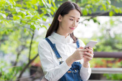 Happy girl and cell phone Stock Image
