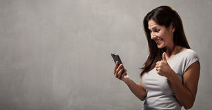 Happy girl with cell phone Royalty Free Stock Image