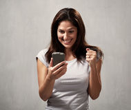 Happy girl with cell phone Royalty Free Stock Images