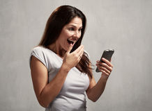 Happy girl with cell phone Royalty Free Stock Photography