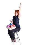 Happy girl on a chair Royalty Free Stock Photos