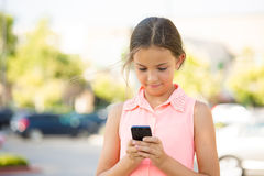 Happy girl checking her new smart phone Royalty Free Stock Photo