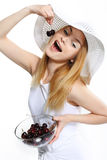 Happy girl with cherry Stock Images