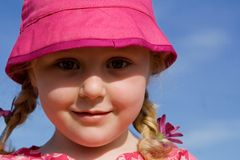 Happy girl child. Happy cute smiling little girl child braids and sunhat Royalty Free Stock Images