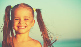 Happy girl child on the beach Royalty Free Stock Photography