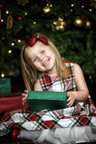 Happy girl child holding a gift in the hands Stock Image