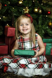 Happy girl child holding a gift in the hands Stock Photography