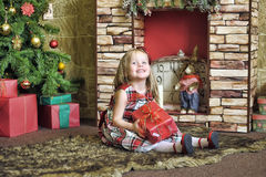 Happy girl child holding a gift in the hands Royalty Free Stock Image