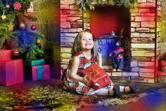 Happy girl child holding a gift in the hands Stock Photo