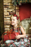 Happy girl child holding a gift in the hands Royalty Free Stock Photo
