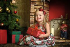 Happy girl child holding a gift in the hands Stock Photos