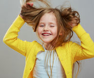 Happy girl child with long blond hair. Stock Image