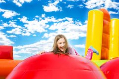 Free Happy Girl Child On Inflate Castle Cloudscape Stock Images - 162338334