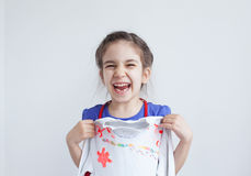 Happy girl, child with white design decorated blouse Stock Photos