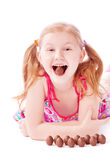 Happy girl with chocolate eggs Stock Images