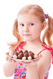Happy girl with chocolate eggs Royalty Free Stock Photos
