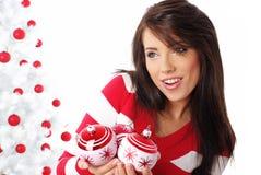 Happy girl with christmas balls Stock Photography