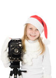 Happy girl in a Christmas costume with old camera Royalty Free Stock Image