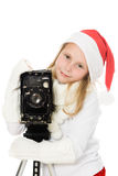 Happy girl in a Christmas costume with old camera Stock Images