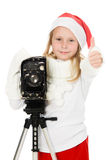 Happy girl in a Christmas costume with old camera Royalty Free Stock Images