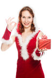 Happy girl in a Christmas dress showing okay sign Royalty Free Stock Photo