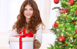 Happy girl with Christmas gift Royalty Free Stock Photos