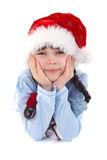 Happy girl in christmas hat Stock Images