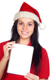 Happy girl with Christmas hat and blank notebook Stock Photography