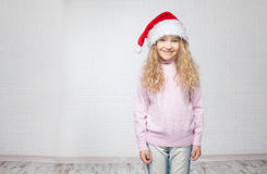 Happy girl in christmas hat Royalty Free Stock Image