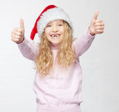 Happy girl in christmas hat Royalty Free Stock Photos