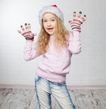 Happy girl in christmas hat. Child in christmas hat on white background. Happy little girl Royalty Free Stock Photos