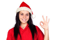 Happy girl with Christmas hat saying Ok Stock Image