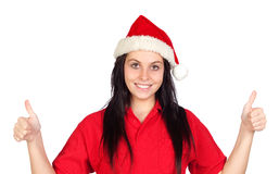 Happy girl with Christmas hat saying Ok Royalty Free Stock Photo