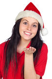 Happy girl with Christmas hat throw a kiss Stock Photo