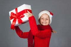 Happy girl with Christmas present Royalty Free Stock Photography
