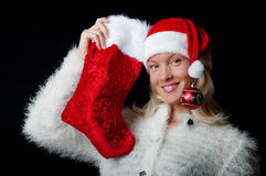 Happy girl with christmas sock Stock Photos