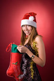 Happy girl with Christmas stocking Royalty Free Stock Images