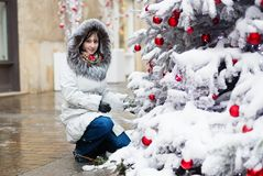 Happy girl with a Christmas tree Royalty Free Stock Photography