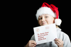 Happy girl with a christmas wish list Royalty Free Stock Photos