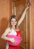 Happy girl cleans furniture Royalty Free Stock Image