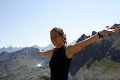 Happy girl climber on a mountain top. Happy smiling girl climber on a mountain top Royalty Free Stock Photography