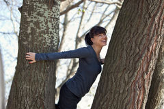 Happy Girl Climbing on Tree Stock Photography