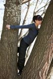 Happy Girl Climbing on Tree Royalty Free Stock Photos