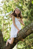 Happy girl climbing in the tree Royalty Free Stock Photos