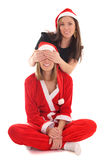 Happy girl closes santas eyes Stock Photos