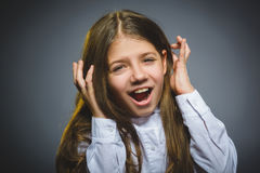 Happy girl. Closeup Portrait handsome child smiling isolated on grey royalty free stock image